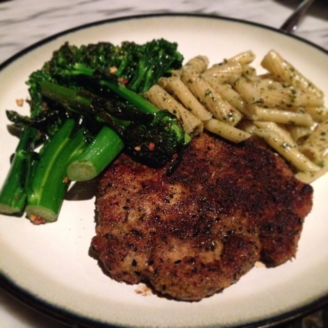 Last night's #noreaster meal in: #homemade pork chops w/ pesto pasta and some sautéed broccoli!