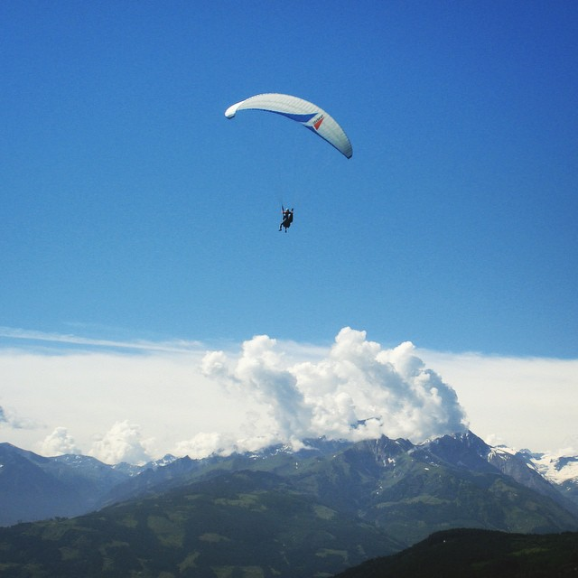 The travel bug is chronic, and I may be on the verge of relapse. #tbt to paragliding in the Austrian alps. #travel #dins #worldtour