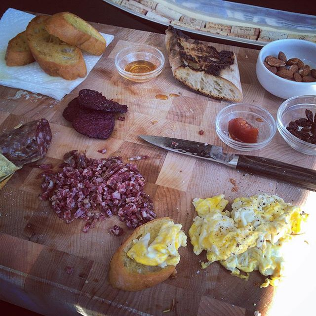 Raided the pantry for a slow weekend #breakfast spread. Ciabatta, wild boar, beet chips, almonds, raisins, honey, and quince.